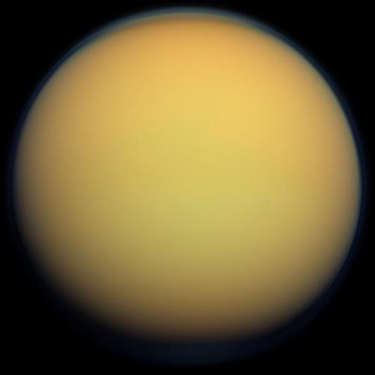 This true-color image of Titan, taken by the Cassini spacecraft, shows the moon's thick, hazy atmosphere. Image: By NASA - http://photojournal.jpl.nasa.gov/catalog/PIA14602, Public Domain, https://commons.wikimedia.org/w/index.php?curid=44822294